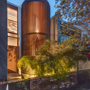 Inspiration for a mid-sized contemporary two-story townhouse exterior remodel in Sydney