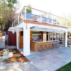 Modern Exterior by Cairn Construction Inc.