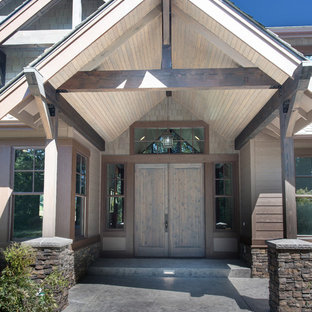 Huge craftsman brown two-story mixed siding exterior home idea in Seattle with a hip roof