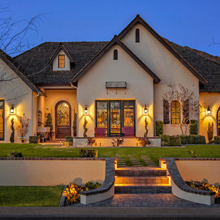 Design ideas for an expansive mediterranean one-storey stucco beige exterior in Phoenix with a hip roof.