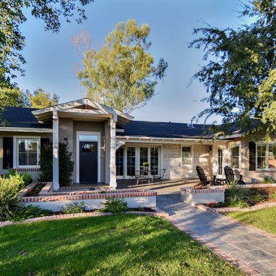 Inspiration for a mid-sized timeless beige one-story mixed siding house exterior remodel in Phoenix with a hip roof and a shingle roof