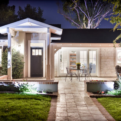 Mid-sized traditional beige one-story mixed siding house exterior idea in Phoenix with a hip roof and a shingle roof