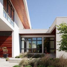 Contemporary Exterior by Hurst Construction, Inc