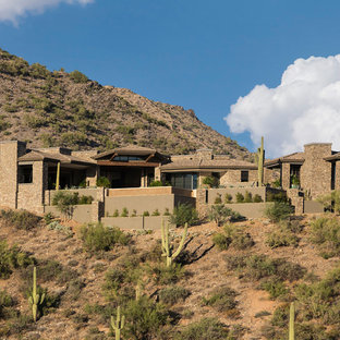 Southwest brown one-story stone house exterior photo in Phoenix with a hip roof and a tile roof