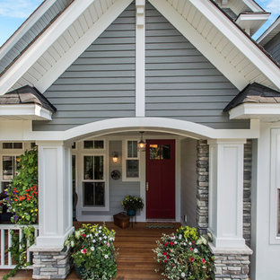 Inspiration for a mid-sized craftsman blue one-story mixed siding gable roof remodel in Minneapolis