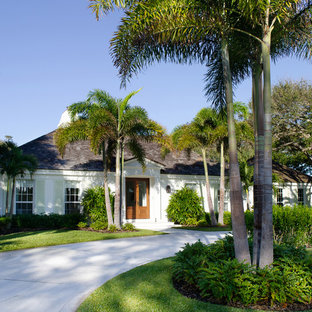 Example of an island style one-story exterior home design in Miami with a hip roof
