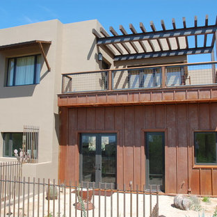 Inspiration for a mediterranean metal exterior home remodel in Phoenix