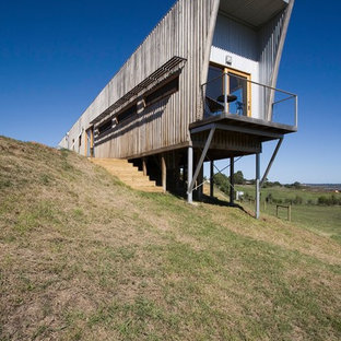 Inspiration for a contemporary one-storey brown house exterior in Melbourne with wood siding and a flat roof.
