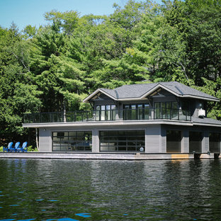 Beach style gray two-story exterior home idea in Toronto with a shingle roof