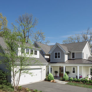 Large country beige two-story concrete fiberboard exterior home idea in DC Metro with a mixed material roof