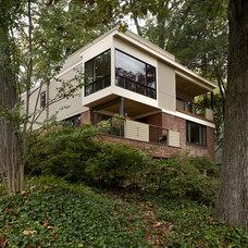 Midcentury Exterior by REVE Design Studio, Inc.