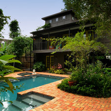 Eclectic Exterior by Greymark Construction Company