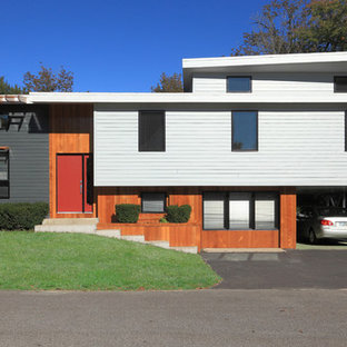 Inspiration for a mid-sized contemporary split-level exterior in Boston with wood siding.