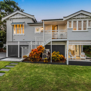 Design ideas for a beach style two-storey grey house exterior in Brisbane with a gable roof.