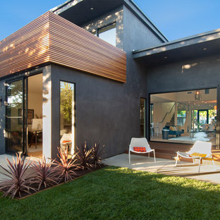 Mid-sized contemporary gray one-story concrete exterior home idea in Los Angeles