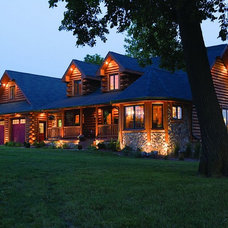 Rustic Exterior by Expedition Log Homes