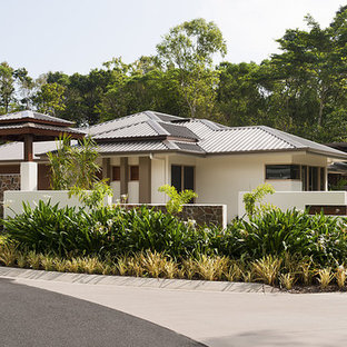 Asian white house exterior in Cairns with a hip roof and a metal roof.