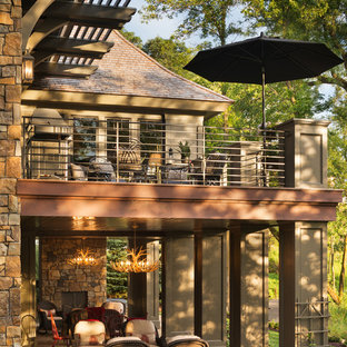 Inspiration for an asian beige one-story mixed siding exterior home remodel in Minneapolis