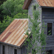 Rustic Exterior by Regan Construction