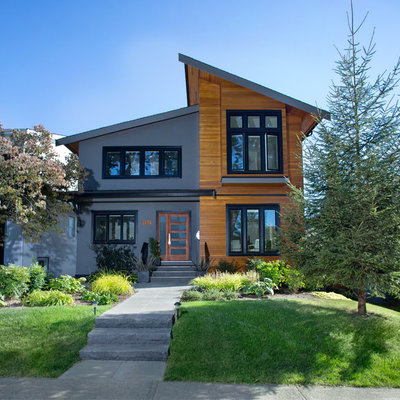 Example of a trendy two-story exterior home design in Vancouver with a shed roof