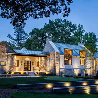 Huge cottage beige one-story mixed siding house exterior idea in Atlanta with a metal roof