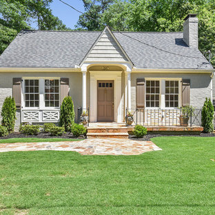 Small Elegant Gray One Story Brick Gable Roof Photo In Atlanta With A  Shingle Roof