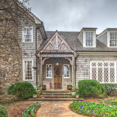 Example of a classic gray two-story exterior home design in Atlanta