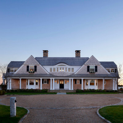 Large coastal beige two-story wood exterior home idea in Boston with a shingle roof