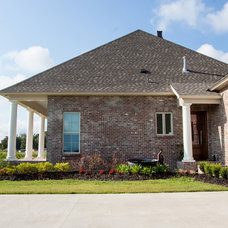 Traditional Exterior by A PLUS Construction