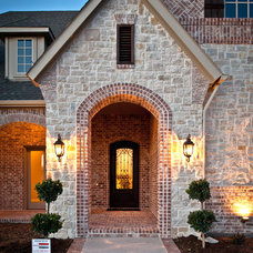 Traditional Exterior by Joseph Paul Homes
