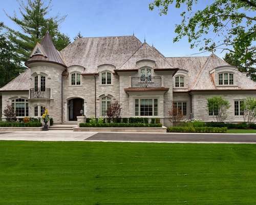 Example Of A Large Classic Stone Exterior Home Design In Toronto With A Hip  Roof