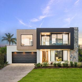 Diseño de fachada de casa multicolor, contemporánea, de dos plantas, con revestimientos combinados y tejado plano