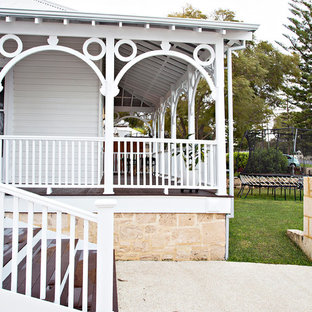 Design ideas for a traditional two-storey white house exterior in Perth with wood siding, a hip roof and a metal roof.