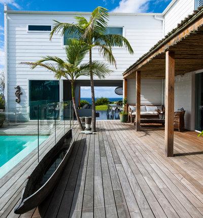Beach Style Exterior by Villa and Villa