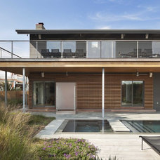 Beach Style Exterior by Brett Webber Architects, PC