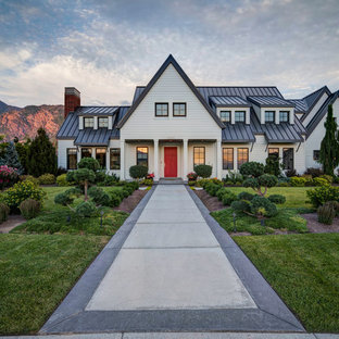 Example of a cottage white two-story gable roof design in Salt Lake City
