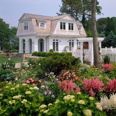 Mid-sized ornate white two-story wood exterior home photo in Boston with a gambrel roof