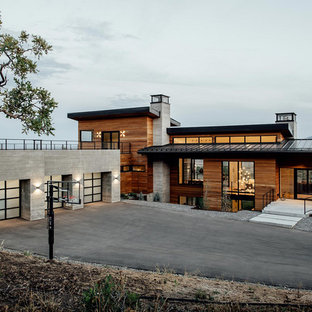 Inspiration for a large contemporary multicolored two-story mixed siding exterior home remodel in Salt Lake City with a green roof