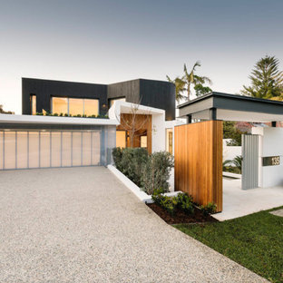 Inspiration for a contemporary multicolored two-story mixed siding exterior home remodel in Miami