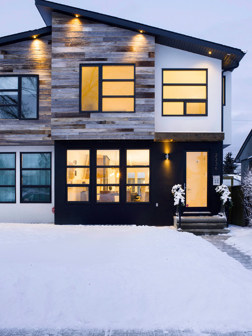 Example of a trendy two-story mixed siding exterior home design in Calgary - Reclaimed Siding Houzz