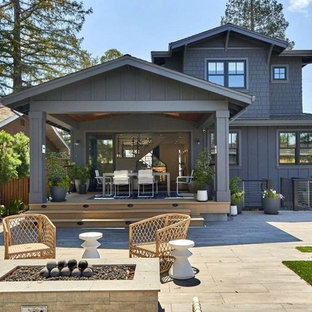Example of a transitional gray two-story wood exterior home design in San Francisco