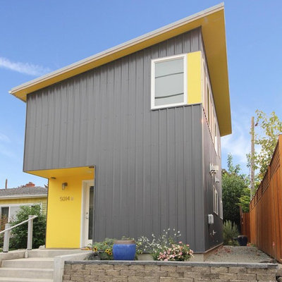 Example of a small trendy gray two-story metal house exterior design in Seattle with a shed roof and a metal roof