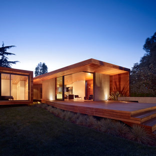 Large modern brown one-story wood flat roof idea in San Francisco