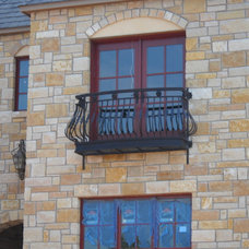 Rustic Exterior by Old World Iron