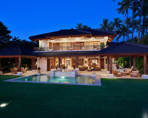 large island style white two story mixed siding exterior home photo in hawaii with a - Balinese Houses Designs