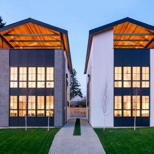 Inspiration for a mid-sized contemporary multicolored mixed siding exterior home remodel in Seattle