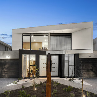 This is an example of a contemporary two-storey multi-coloured duplex exterior in Melbourne with a shed roof.
