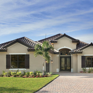 Example of a tuscan exterior home design in Tampa