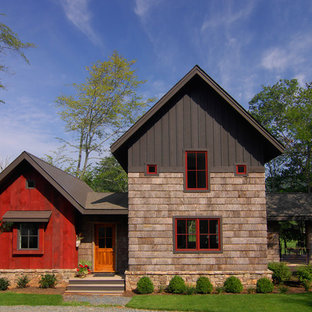 Inspiration for a rustic wood exterior home remodel in Charlotte