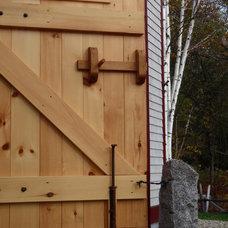 Farmhouse Exterior by Black Dog Timberworks LLC